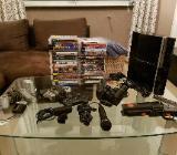 Playstation 3 mit Spielen und Zubehör - Diepholz