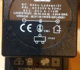 Original Netzteil Frog-Toys Akku Ladegerät DC 5,5-11 V 90.55 mA - Verden (Aller)