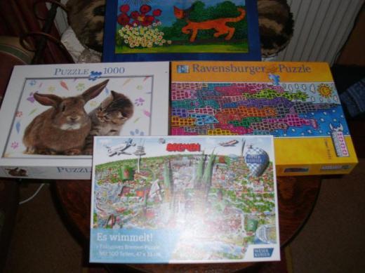 4 x  1000 Teile Puzzle       + 1 x 500 Teile Puzzle - Schwanewede